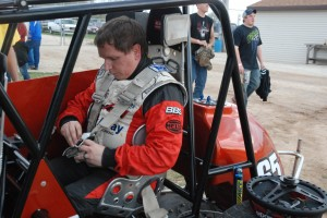 "Full Throttle Editor Bert Lehman straps into the ""passenger seat"" of a two-seat Sprint Car. (Full Throttle photo)"